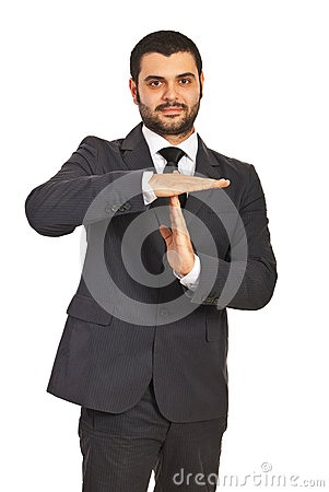 Business man gesture time out