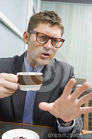 Business Man Gesturing While Having Coffee