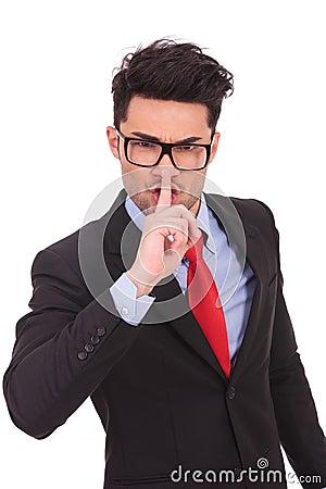 Business man gesturing shut up