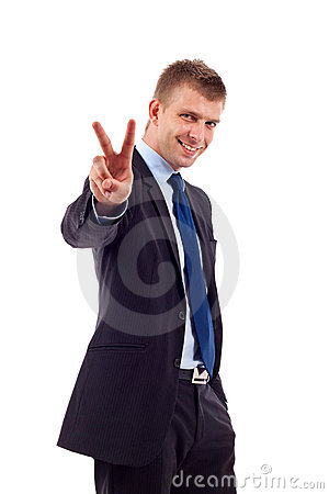 Business man gesturing victory
