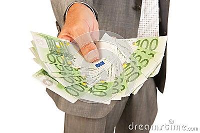 Business man giving euros