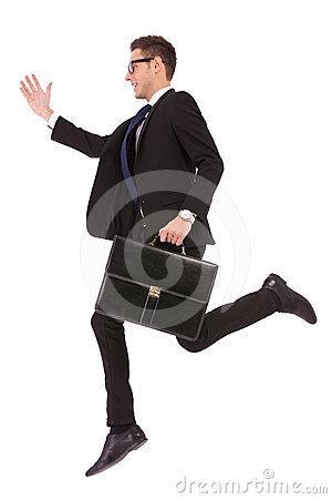 Business man with glasses and suitcase jumping