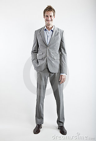 Business man in grey suit on white background