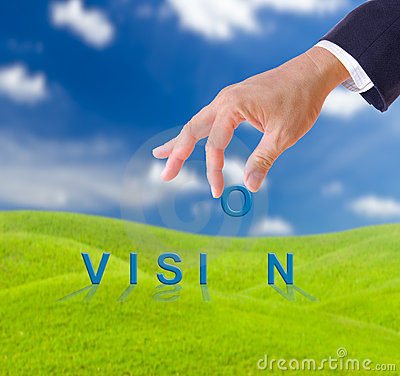 Business man hand and vision word