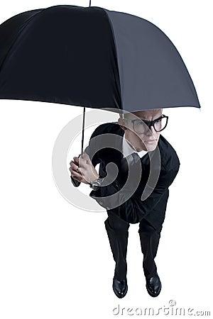 Business man hiding under an umbrella