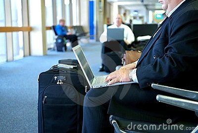 Business man on his laptop in the airport