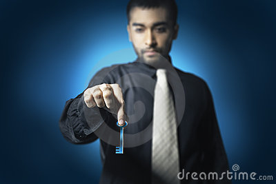 Business man hold key
