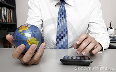 Business man holding a globe