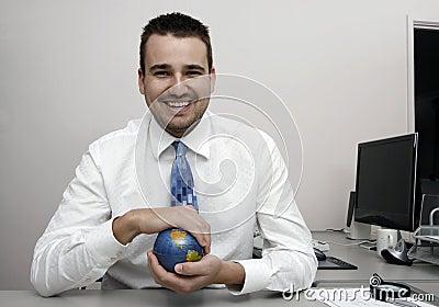 Business man holding a globe