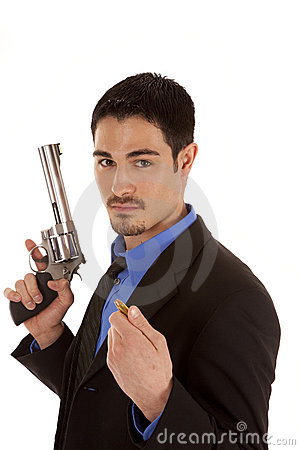 Business man holding gun and bullet
