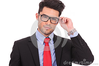 Business man holding his eyeglasses