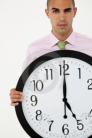 Business man holding a large clock
