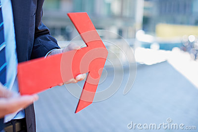 Business man holding red arrow