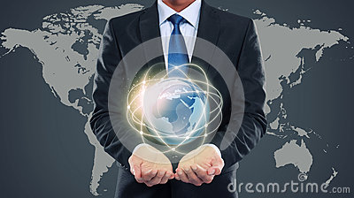 Business man holding the small world of multimedia