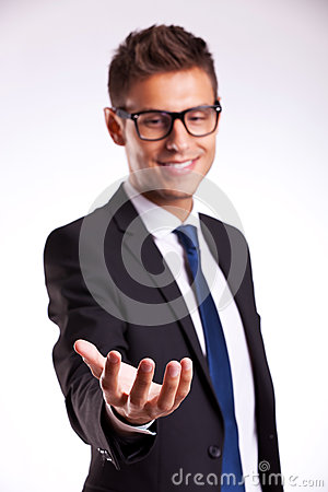 Business man holding something on his hand
