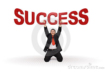 Business man holding success text