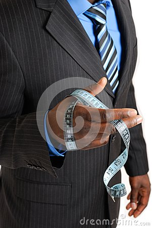 Business man holding tape measure