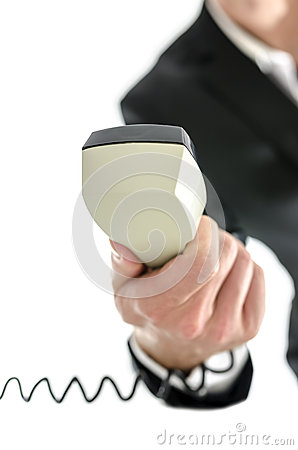 Business man holding telephone receiver
