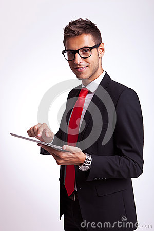 Business man holding a touch screen pad