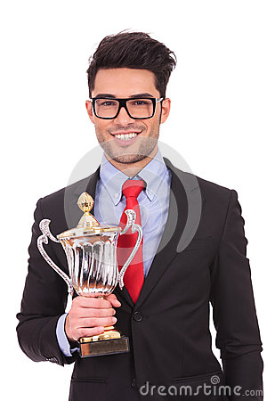 Business man holds trophy