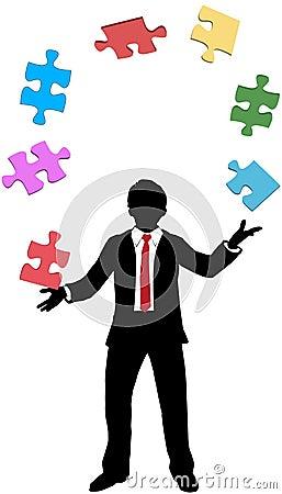 Business man juggling puzzle pieces problems