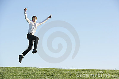 A business man jumping for joy