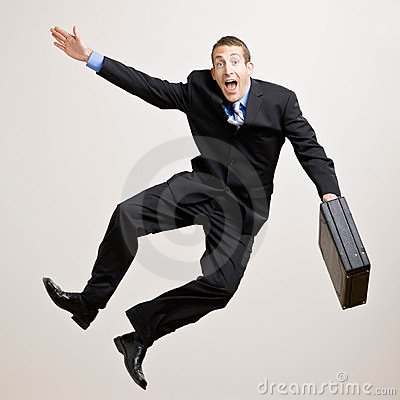 Business man jumps in the air