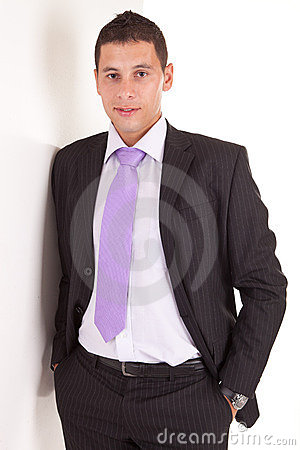 Business man leaning against wall