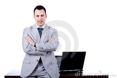 Business man leaning on office desk