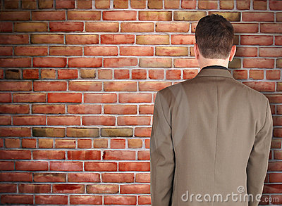 Business Man Looking at Brick Wall Obstacle