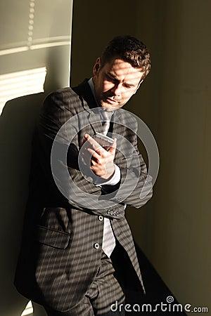 Business man looking at display of palmtop