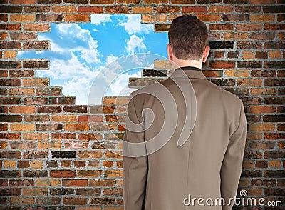 Business Man Looking at Hope Wall
