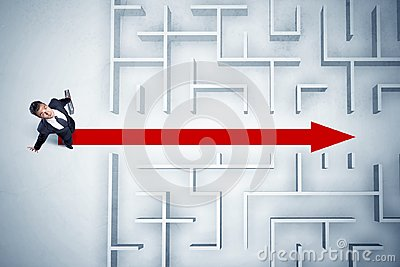 Business man looking at maze with red arrow Stock Photo