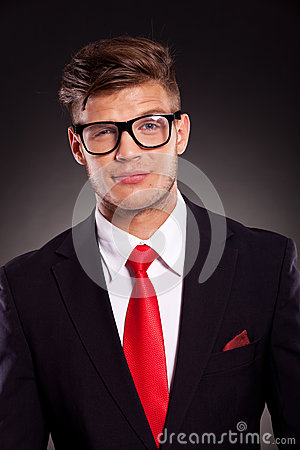 Business man looking suspiciously