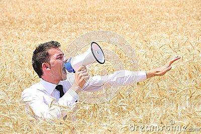 Business Man with loudspeaker