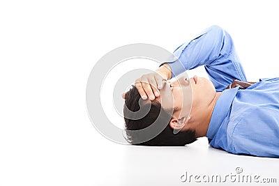 Business man lying on floor