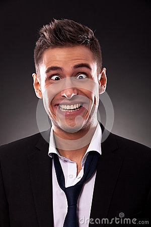 Free Business Man  Making A Silly Face Royalty Free Stock Photo - 26398675
