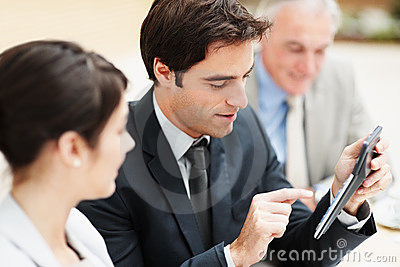 Business man making calculations during a meeting