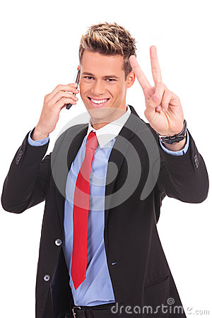 Business man making victory on phone
