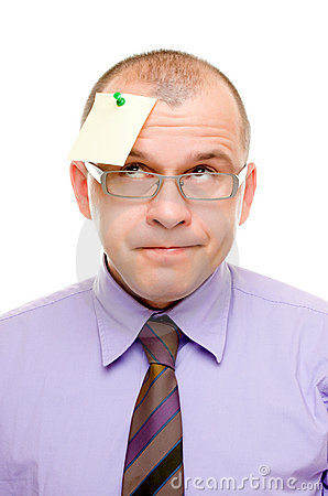Business man with note pinned on his head
