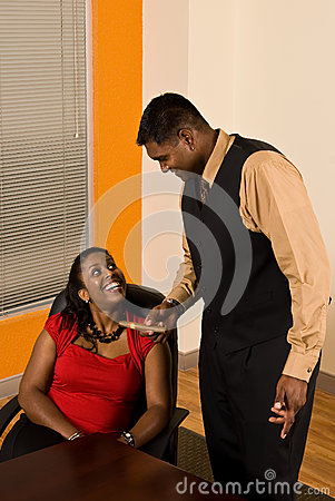Business Man Offers his Business Woman a Cigar