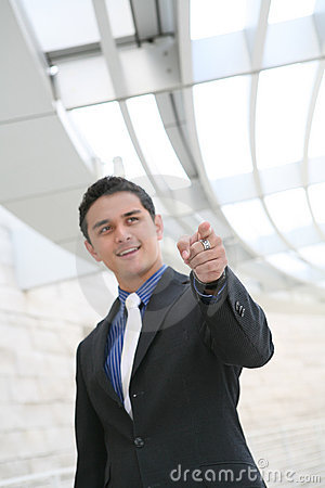Business Man Pointing with Office Building