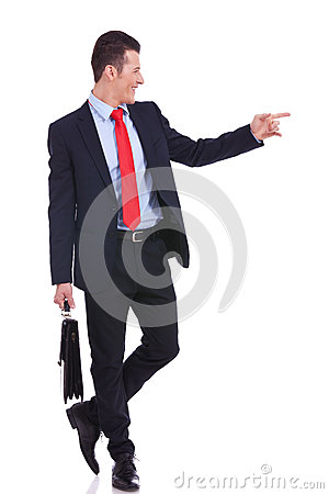 Business man pointing to his side