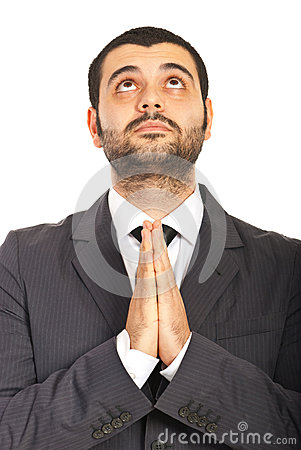 Business man praying and wishing