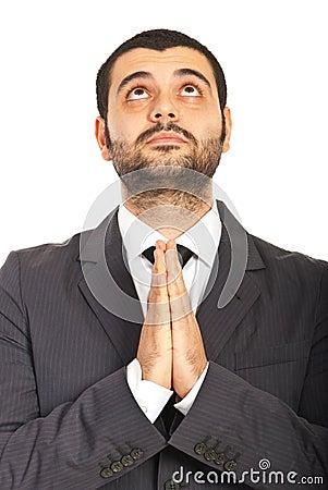 Business man praying and wishing