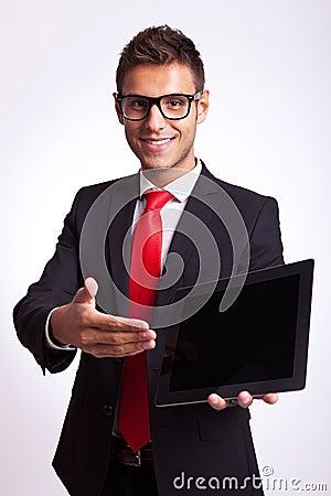 Business man presenting pad