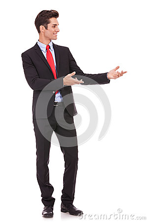 Business man presenting something or inviting