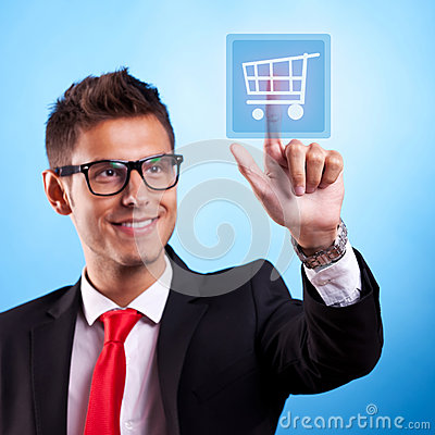 Business man pressing a shopping button
