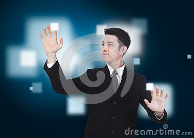 Business man pressing a touchscreen