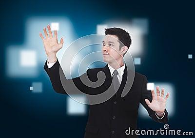 Business man pressing a touchscreen